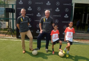 Mr.-Roland-Folger-MD-CEO-Mercedes-Benz-India-and-Andy-Griffiths-Global-Director-Laureus-Sport-for-Good-all-set-to-play-football-with-OSCAR-Foundation-kids-300x208