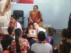 Kids gifting painting to Dia Mirza at Save the children Aadhaar card camp