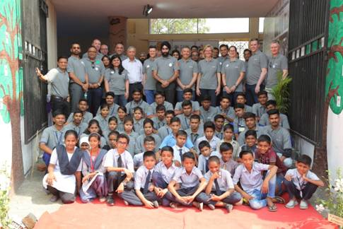 Team UBS with children at Pratham Arora Center for Education (PACE)