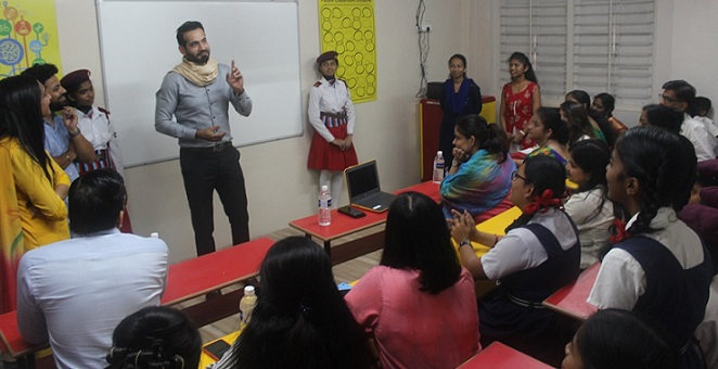 Irfan Pathan interacting with the school kids