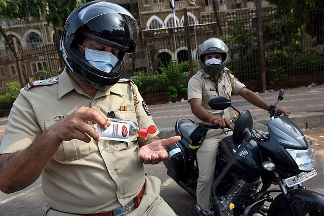 Hand sanitizers distributed to Mumbai Police by HUL and Fullarton Distilleries