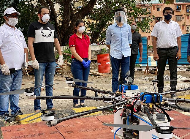 Embassy Services team and Aaditya Thackeray with a disinfectant drone