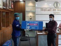 Handing over PPE kits to CEO Nandurbar Vinay Gauda